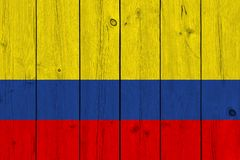 Colombia flag painted on old wood plank. Patriotic background. National flag of Colombia stock image