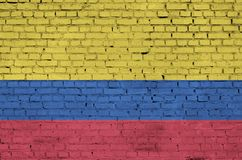 Colombia flag is painted onto an old brick wall stock illustration