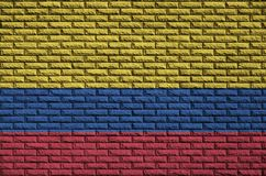 Colombia flag is painted onto an old brick wall royalty free illustration