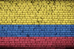 Colombia flag is painted onto an old brick wall stock photography
