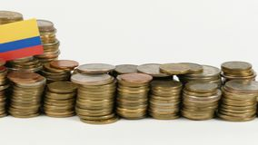 Colombia flag with stack of money coins stock footage