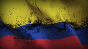 Colombia grunge dirty flag waving on wind. Colombian background fullscreen grease flag blowing on wind. Realistic filth fabric texture on windy day Royalty Free Stock Photos