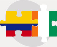 Colombia and Ivory Coast Flags in puzzle Stock Photos