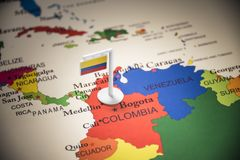 Colombia marked with a flag on the map.  royalty free stock photo