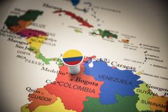Colombia marked with a flag on the map.  stock image