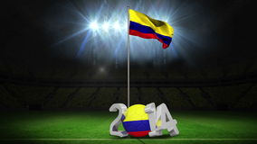 Colombia national flag waving on football pitch with message stock footage