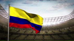 Colombia national flag waving on stadium arena stock video