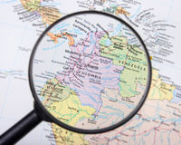 Colombia under magnifier. Destination Colombia under magnifying glass Royalty Free Stock Images