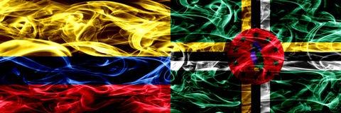 Colombia versus Dominica zij aan zij geplaatste rookvlaggen Dik gekleurde zijdeachtige rookvlaggen van Columbiaans en Dominica royalty-vrije illustratie