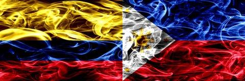 Colombia versus Filippijnen, Filipijnse zij aan zij geplaatste rookvlaggen Dik gekleurde zijdeachtige rookvlaggen van Columbiaans stock illustratie