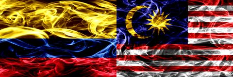 Colombia versus Maleisië, Maleise zij aan zij geplaatste rookvlaggen Dik gekleurde zijdeachtige rookvlaggen van Columbiaans en Ma royalty-vrije illustratie