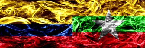 Colombia versus Myanmar zij aan zij geplaatste rookvlaggen Dik gekleurde zijdeachtige rookvlaggen van Columbiaans en Myanmar royalty-vrije illustratie