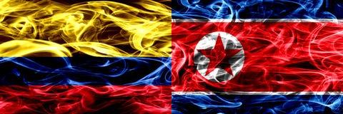 Colombia versus Noord-Korea, Koreaanse zij aan zij geplaatste rookvlaggen Dik gekleurde zijdeachtige rookvlaggen van Columbiaans  royalty-vrije illustratie