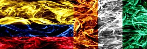 Colombia versus zij aan zij geplaatste de rookvlaggen van Ivoorkust Dik gekleurde zijdeachtige rookvlaggen van Columbiaans en Ivo vector illustratie