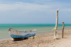 Colombia. Wild coastal desert of Penisula la Guajira near the Cabo de la Vela resort. The picture present traditional fishing boat royalty free stock photography
