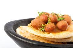 Colombian arepa topped with beans Stock Photography