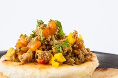 Colombian arepa topped with ground beef Royalty Free Stock Photos