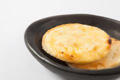 Colombian arepa topped with melted butter Royalty Free Stock Photo