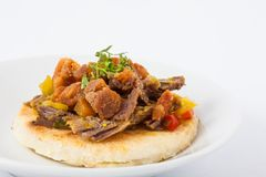 Colombian arepa topped with shredded beef and pork rind. Traditional Colombian arepa topped with shredded beef and pork rind Stock Photography