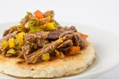 Colombian arepa topped with shredded beef Stock Image