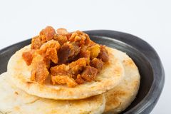 Colombian Arepa Topped With Pork Rind Royalty Free Stock Photos