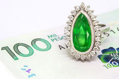 Colombian Emerald Ring and Money Royalty Free Stock Images