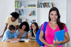 Colombian female student with group of international students. At library of university royalty free stock image