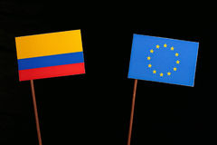 Colombian flag with European Union EU flag isolated on black Royalty Free Stock Image