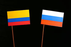 Colombian flag with Russian flag isolated on black Stock Image