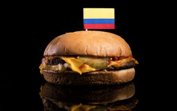 Colombian flag on top of hamburger isolated on black Stock Photos