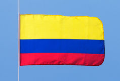 Colombian flag in wind against the sky Royalty Free Stock Photo