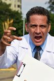 Colombian Male Doctor Under Stress Wearing Lab Coat. A handsome adult hispanic man Royalty Free Stock Photos