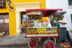 Colombian man selling fruit juice in the street of Cartagena, Co Royalty Free Stock Images