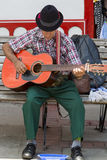 Colombian musician playing music in the street of Salento, Colom Stock Photos