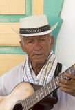 Colombian musician playing music in the street of Salento, Colom Royalty Free Stock Images