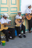 Colombian musicians playing music in the street of Salento, Colo Stock Images