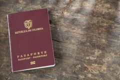 Colombian passport ready to travel abroad. Colombian passport on wooden background Royalty Free Stock Photos