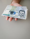 Colombian Peso. Hand holding a stack of 20.000 Colombian Peso Bills Stock Image