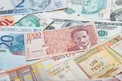 Colombian peso in the middle. Background from paper money of the different countries. Colombian peso in the middle Stock Photos