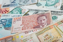 Colombian peso in the middle. Background from paper money of the different countries. Colombian peso in the middle Royalty Free Stock Images