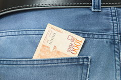 Colombian Pesos in jeans pocket. Background Royalty Free Stock Photo