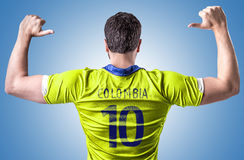 Colombian soccer player on blue background Royalty Free Stock Images