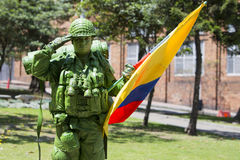 Colombian Soldier and flag in the street of Bogota Stock Images