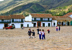 Colombian students, main square Villa de Leyva. Schoolchildren in uniform. Main square Villa de Leyva, Colombia Stock Image