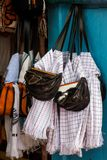 Colombian traditional carriel and poncho from Antioquia. Colombian traditional leather satchel from the Antioquia Region called Carriel and poncho Stock Photography
