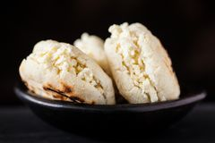 Colombian traditional white corn arepa stuffed with grated cheese