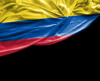 Colombian waving flag on black background Stock Image