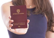 Colombian woman with passport. In her hands Stock Images
