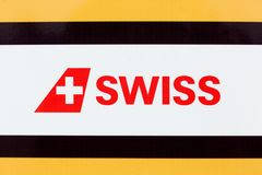 Swiss International Air Lines logo on a panel. Colombier-Saugnieu, France - March 22, 2018: Swiss International Air Lines logo on a panel. Swiss is the flag royalty free stock photos