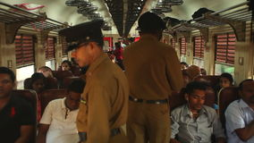 COLOMBO, SRI LANKA - FEBRUARY 2014: Local people traveling in train, while conducters are checking the tickets. The Sri Lankan rai. Lway transports millions of stock video